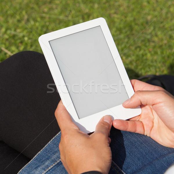 Mulher leitura ebook grama praça imagem Foto stock © michaklootwijk