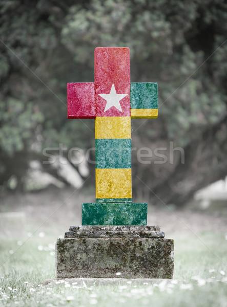 кладбище Того старые выветрившийся флаг Сток-фото © michaklootwijk
