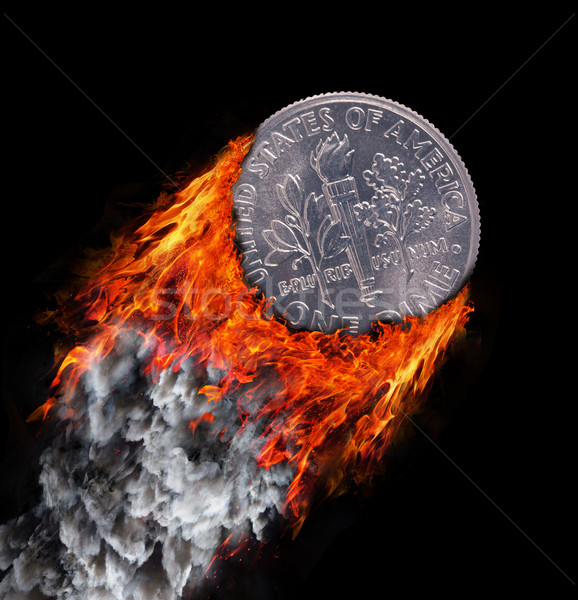 Stock photo: Burning coin with a trail of fire and smoke
