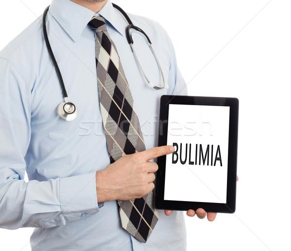 Doktor tablet bulimia yalıtılmış beyaz Stok fotoğraf © michaklootwijk
