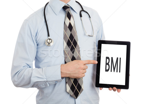 Doctor holding tablet - BMI Stock photo © michaklootwijk