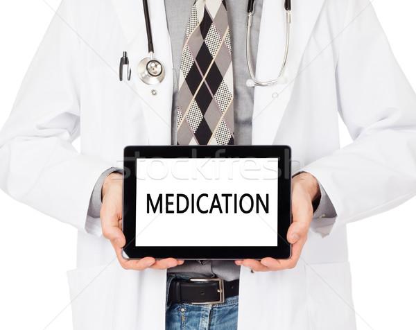 Médecin comprimé médication isolé blanche Photo stock © michaklootwijk