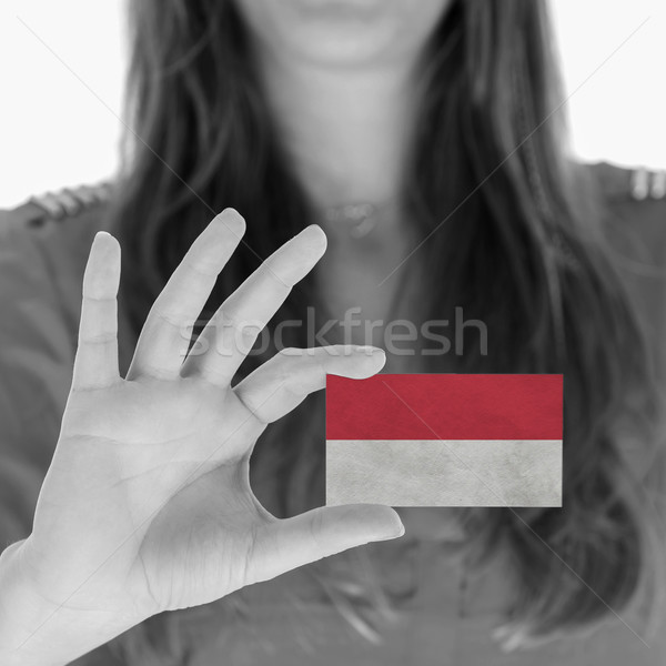 Woman showing a business card Stock photo © michaklootwijk