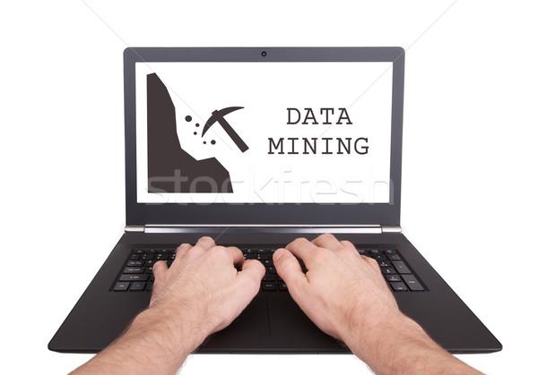 Uomo lavoro laptop dati mining isolato Foto d'archivio © michaklootwijk