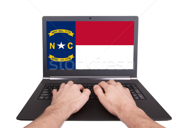 Hands working on laptop, North Carolina Stock photo © michaklootwijk