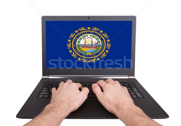 Eller çalışma dizüstü bilgisayar New Hampshire ekran Stok fotoğraf © michaklootwijk