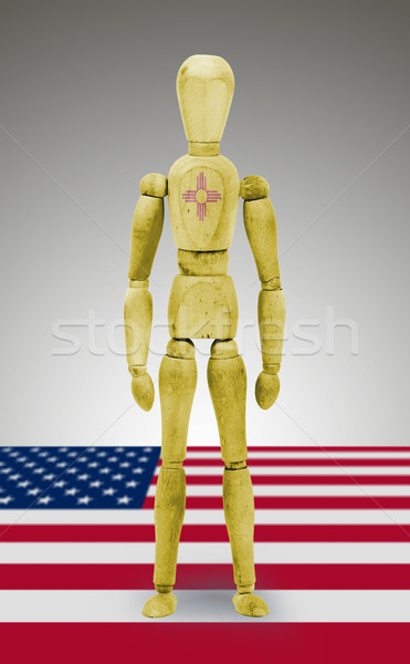 Stock photo: Wood figure mannequin with US state flag bodypaint - New Mexico