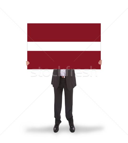 Foto d'archivio: Imprenditore · grande · carta · bandiera · Lettonia