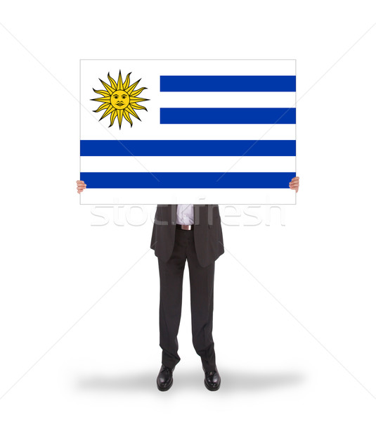 Smiling businessman holding a big card, flag of Uruguay Stock photo © michaklootwijk