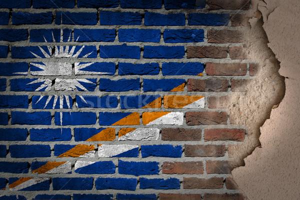 Escuro parede de tijolos gesso textura bandeira Foto stock © michaklootwijk