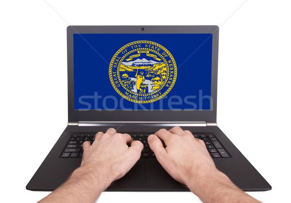 Mãos trabalhando laptop Nebraska tela Foto stock © michaklootwijk