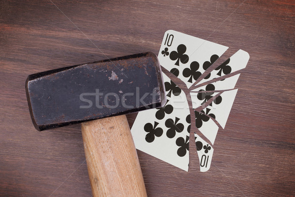 Hammer with a broken card, ten of clubs Stock photo © michaklootwijk