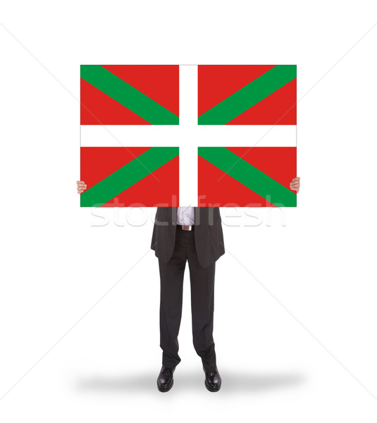 Smiling businessman holding a big card, flag of Basque Country Stock photo © michaklootwijk