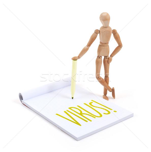 Wooden mannequin writing - Virus Stock photo © michaklootwijk