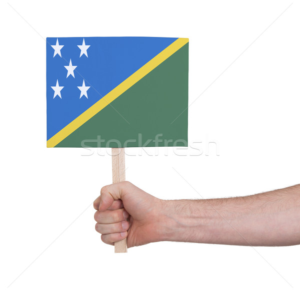 Hand holding small card - Flag of Solomon Islands Stock photo © michaklootwijk