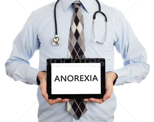 Orvos tart tabletta anorexia izolált fehér Stock fotó © michaklootwijk