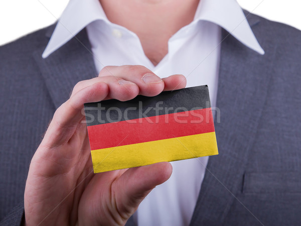 Businessman showing card, matte paper effect Stock photo © michaklootwijk