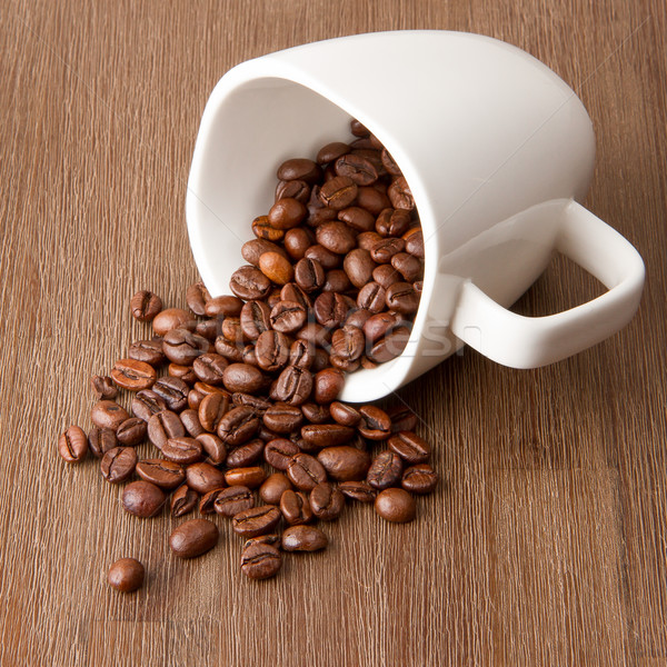 Coffee cup and spilled coffee beans Stock photo © michaklootwijk