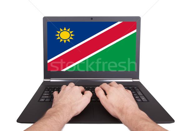Eller çalışma dizüstü bilgisayar Namibya ekran Stok fotoğraf © michaklootwijk
