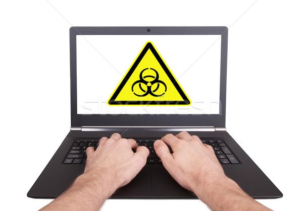 Férfi dolgozik laptop bioveszély izolált kéz Stock fotó © michaklootwijk