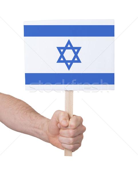 Kéz tart kicsi kártya zászló Izrael Stock fotó © michaklootwijk
