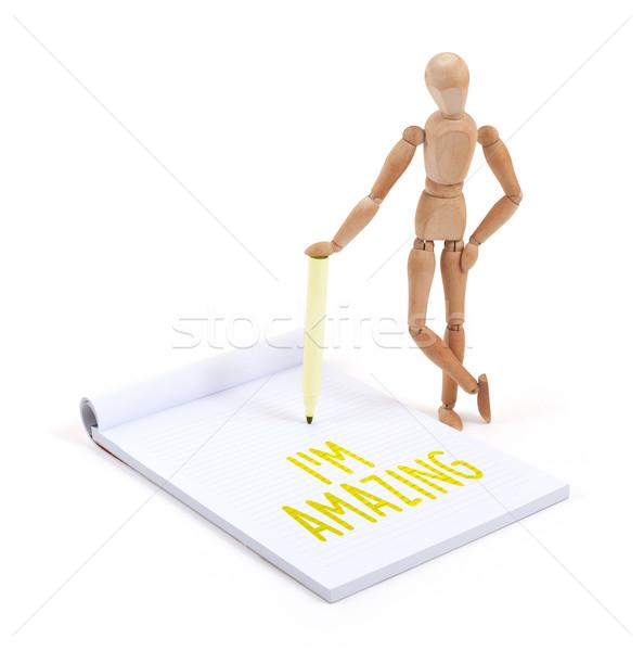 Wooden mannequin writing - I'm amazing Stock photo © michaklootwijk