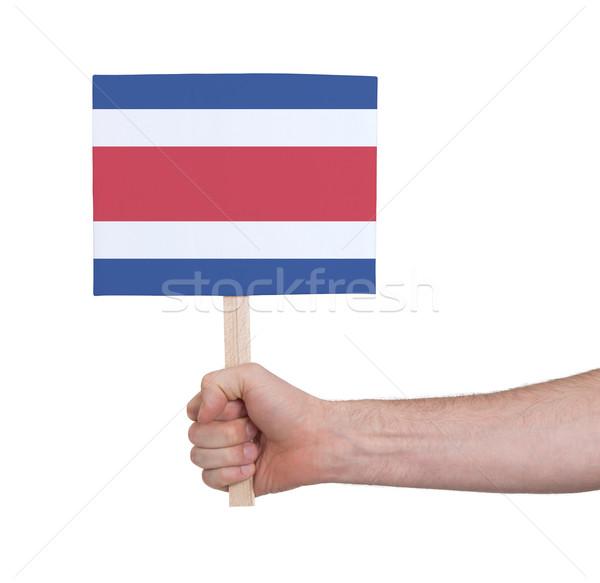 Kéz tart kicsi kártya zászló Costa Rica Stock fotó © michaklootwijk