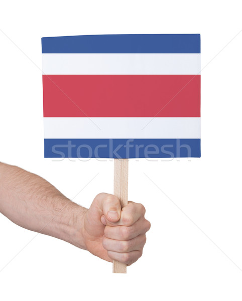 Hand holding small card - Flag of Costa Rica Stock photo © michaklootwijk