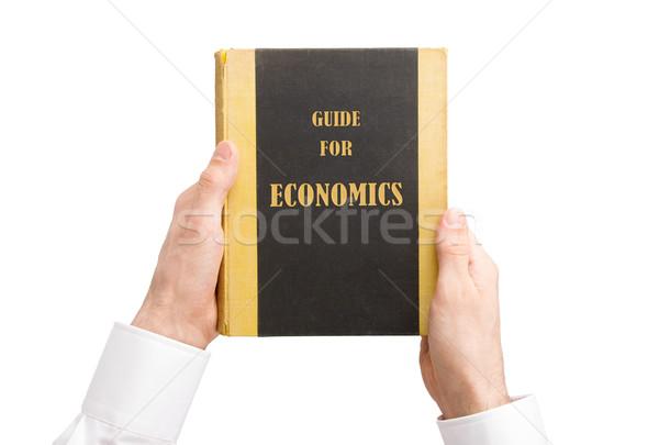 üzletember tart régi könyv útmutató közgazdaságtan pénz Stock fotó © michaklootwijk