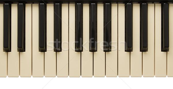 Old slightly yelow piano keyboard Stock photo © michaklootwijk