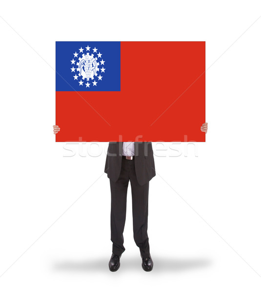 Stock photo: Businessman holding a big card, flag of Myanmar