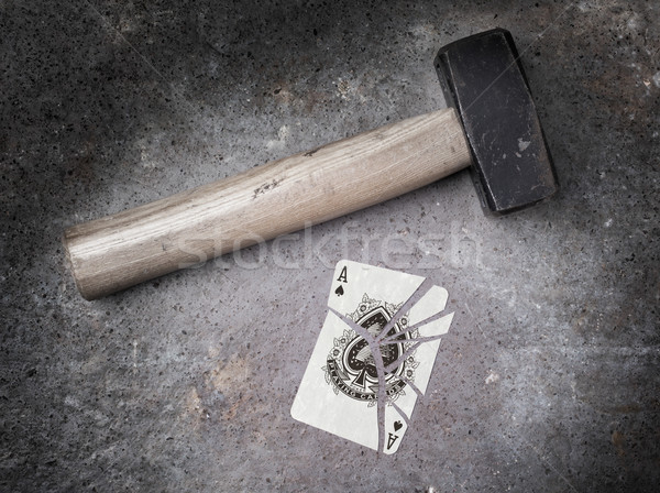 Stock photo: Hammer with a broken card, ace of spades
