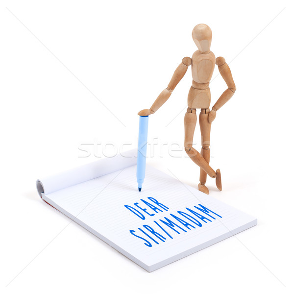 Wooden mannequin writing in scrapbook - Dear sir madam Stock photo © michaklootwijk
