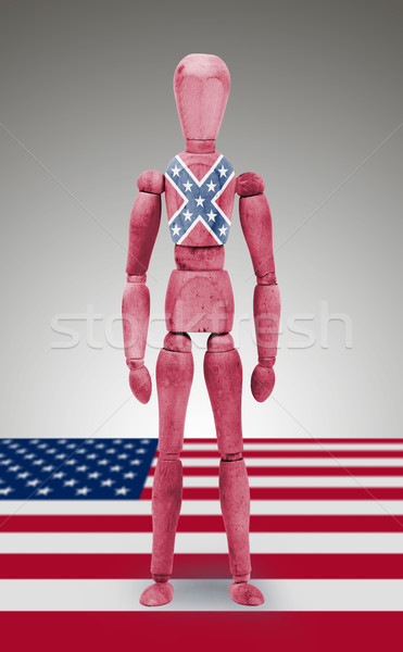 Jointed wooden mannequin isolated on white background, Confedera Stock photo © michaklootwijk
