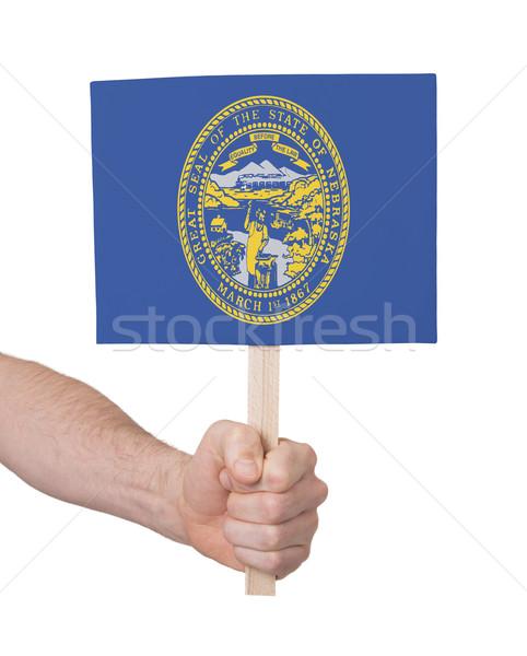 Mão pequeno cartão bandeira Nebraska Foto stock © michaklootwijk