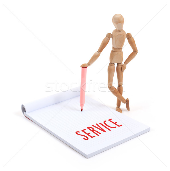 Wooden mannequin writing - Service Stock photo © michaklootwijk