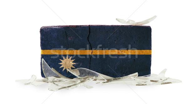 Mattone vetri rotti violenza bandiera Nauru muro Foto d'archivio © michaklootwijk