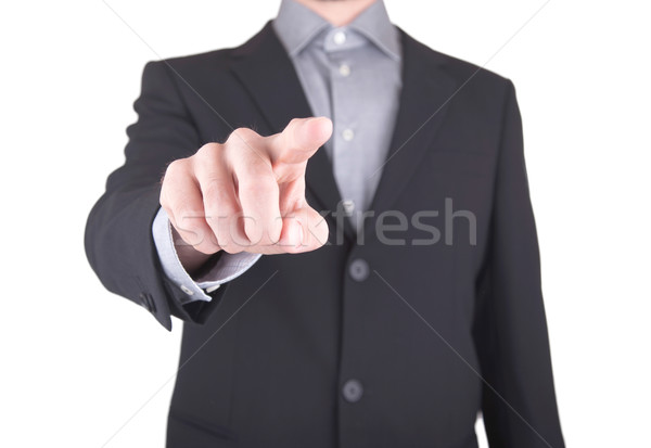 Business man in suit pushing a button Stock photo © michaklootwijk