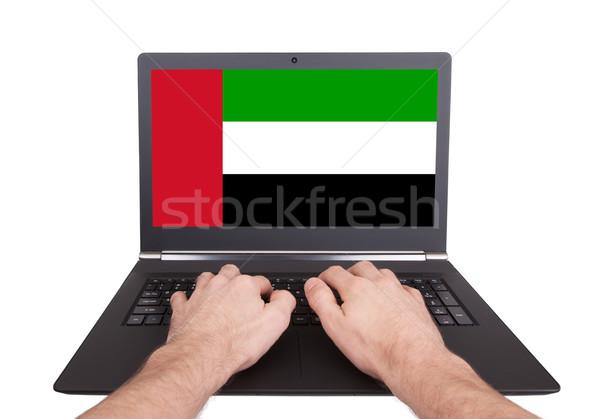 Hands working on laptop, UAE Stock photo © michaklootwijk