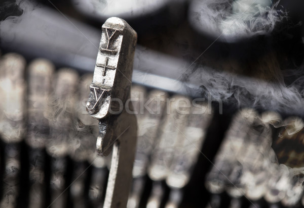 Y hammer - old manual typewriter - mystery smoke Stock photo © michaklootwijk