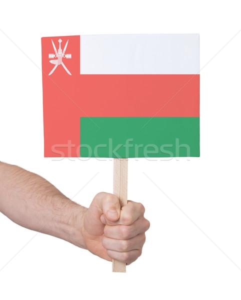 Kéz tart kicsi kártya zászló Omán Stock fotó © michaklootwijk