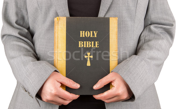 Woman in business suit is holding a holy bible Stock photo © michaklootwijk