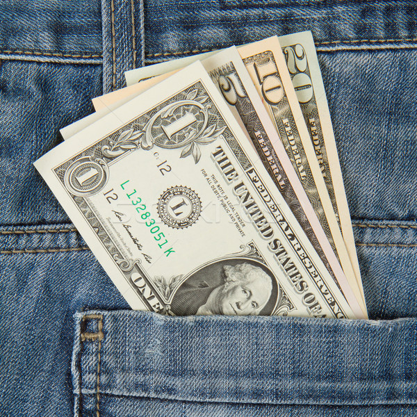 Macro shot of trendy jeans with american four different dollar b Stock photo © michaklootwijk