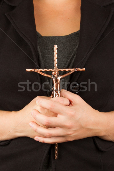 Woman in black with the cross in hands Stock photo © michaklootwijk