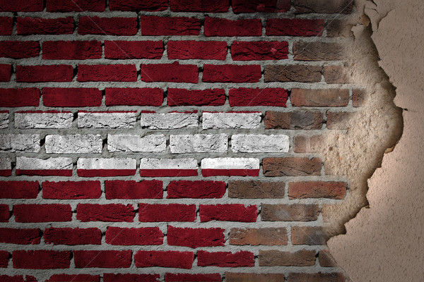 Karanlık tuğla duvar sıva Letonya doku bayrak Stok fotoğraf © michaklootwijk
