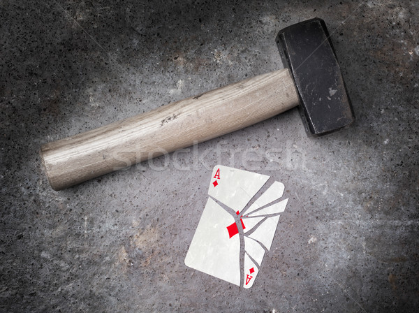 Hammer with a broken card, ace of diamonds Stock photo © michaklootwijk