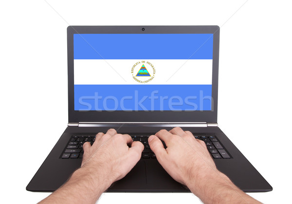 Mãos trabalhando laptop Nicarágua tela Foto stock © michaklootwijk