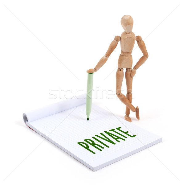 Wooden mannequin writing - Private Stock photo © michaklootwijk