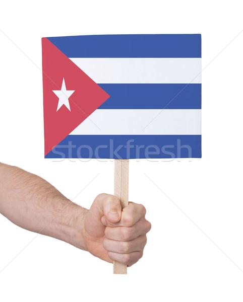 Kéz tart kicsi kártya zászló Kuba Stock fotó © michaklootwijk
