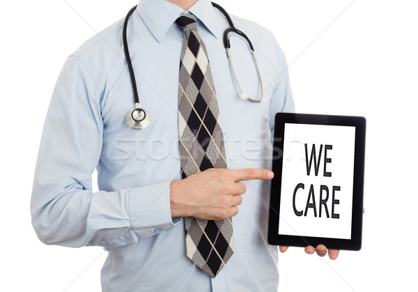 Doctor holding tablet - We care Stock photo © michaklootwijk